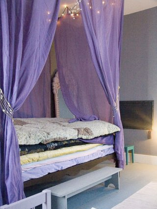 Purple curtains bed